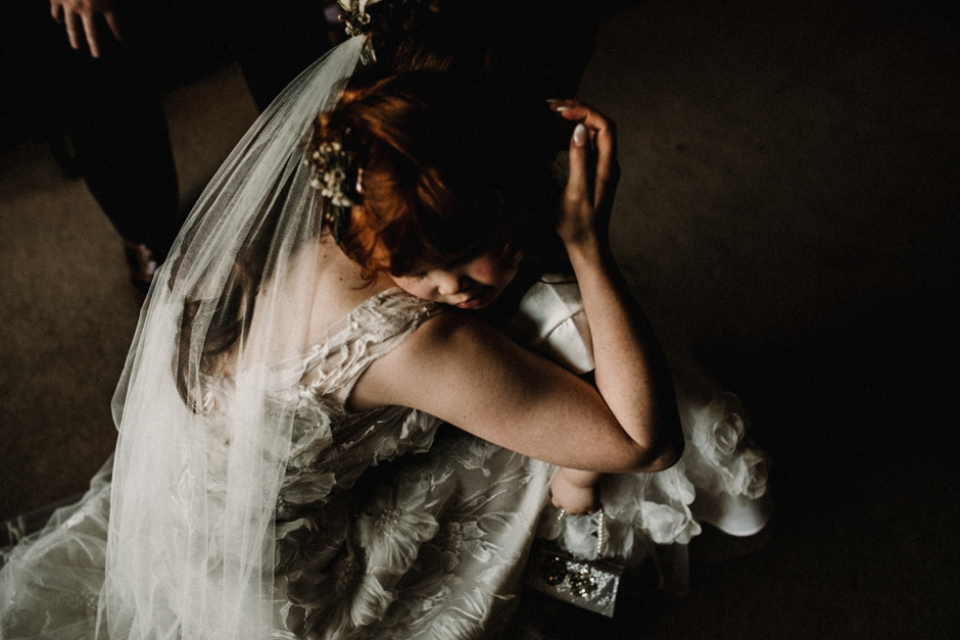 bride and flower girl having a cuddle at Hever castle