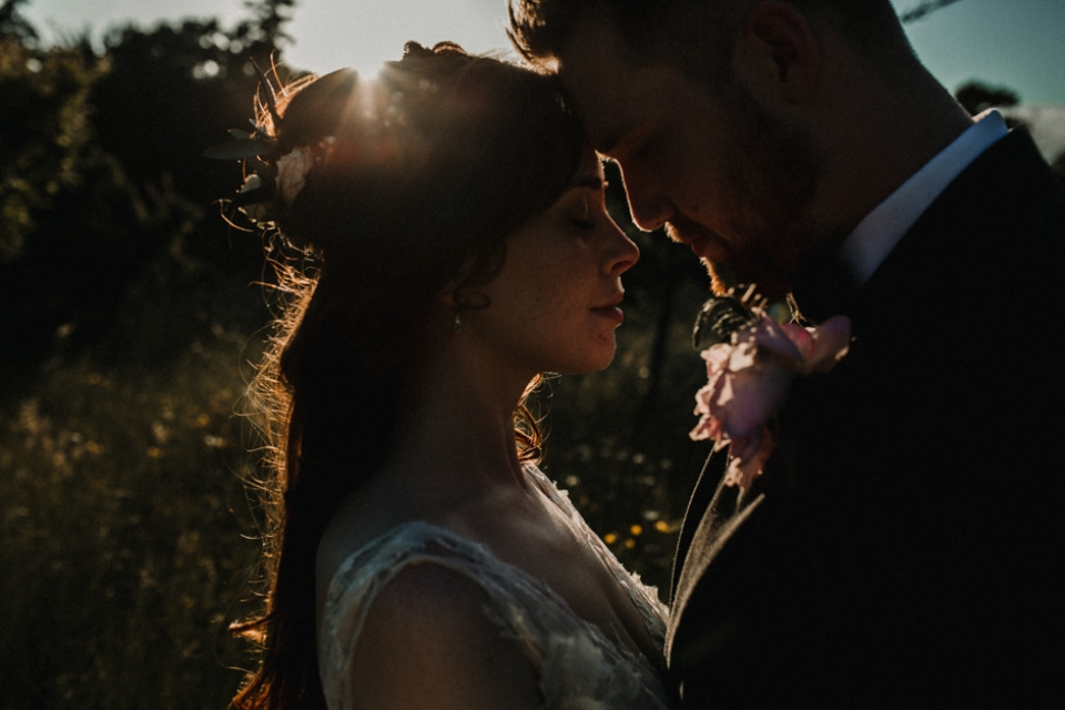 couple relaxing together , wedding photography at golden hour