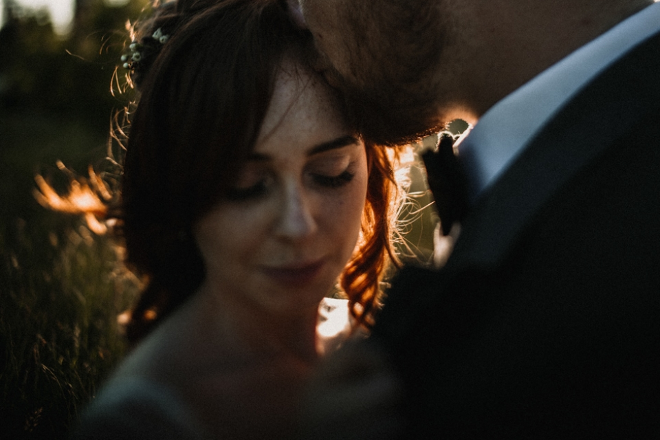 red haired bride and husband during golden hour light , kent wedding photography