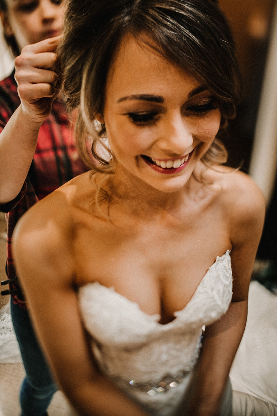 bride getting into her dress at bridal prep