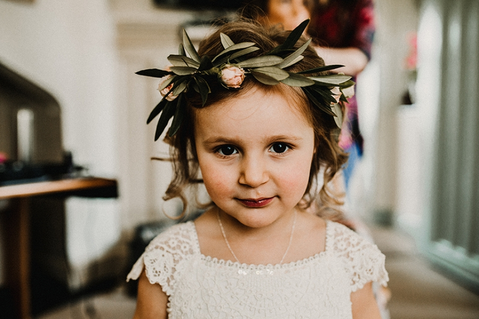 flower girl showing off her flower crown