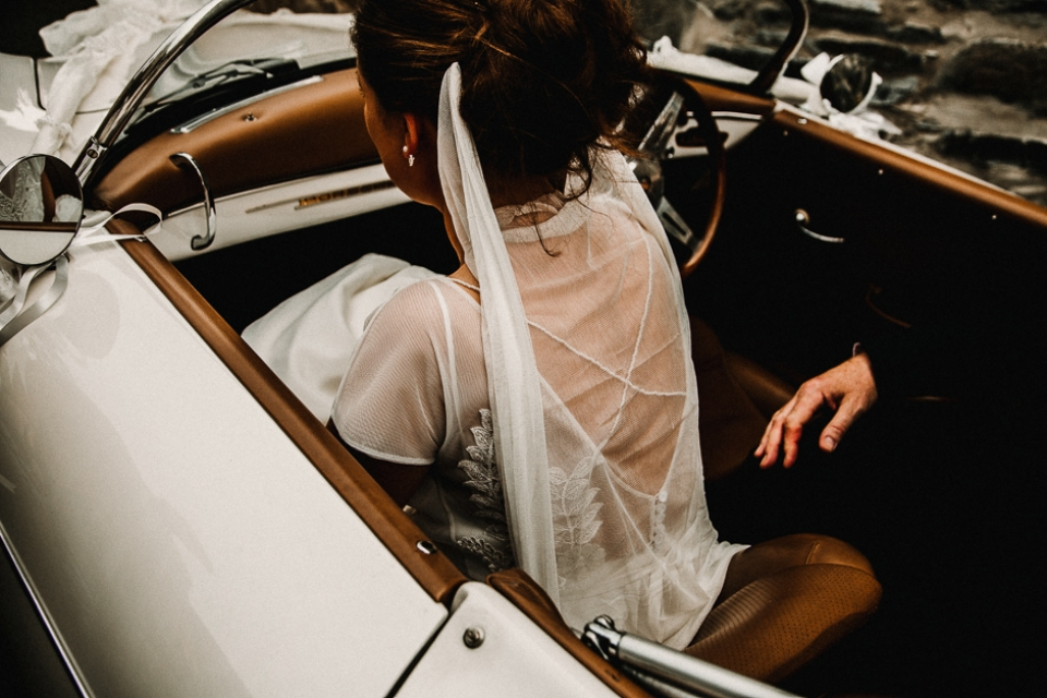 bride getting out of her wedding car
