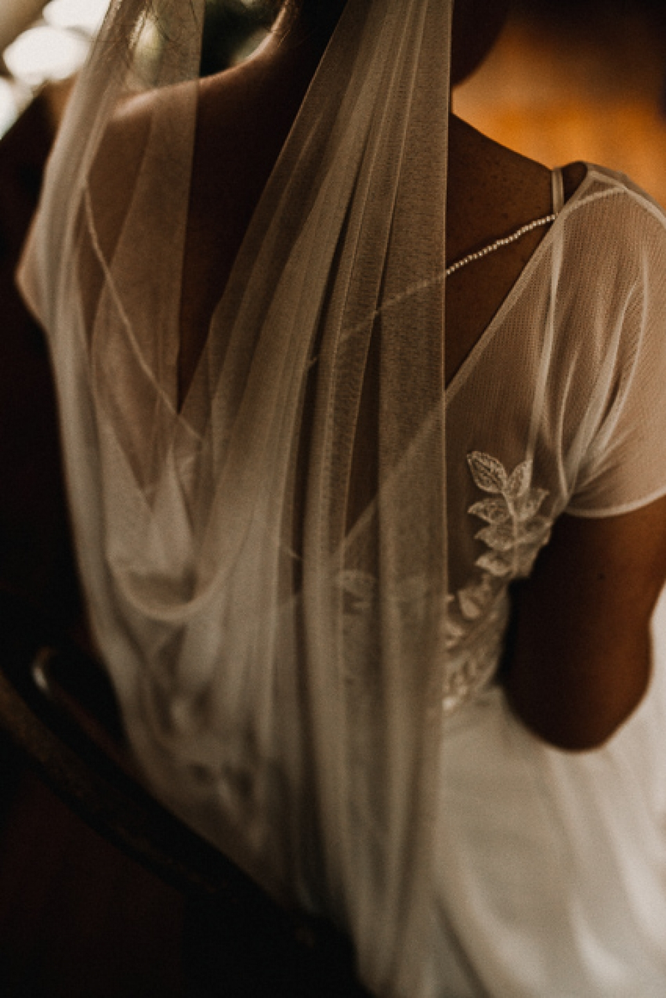 details of the back of brides dress