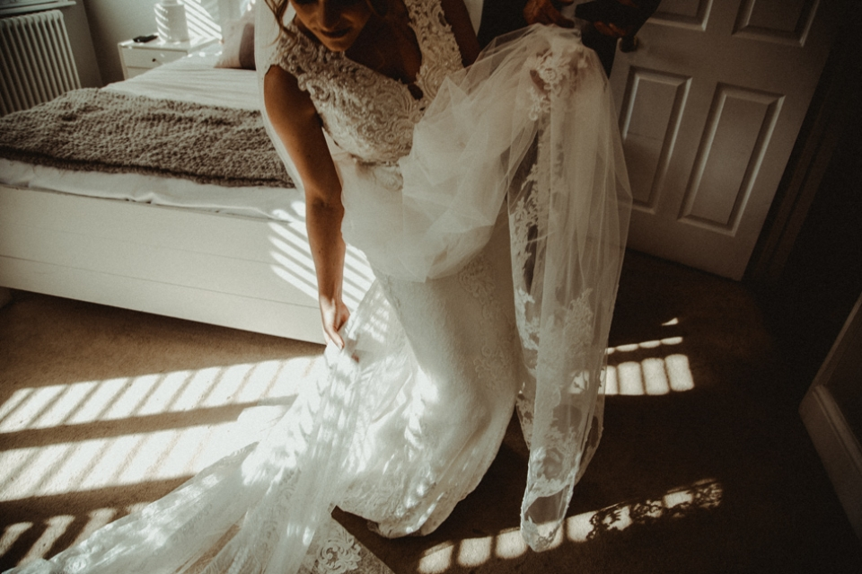 bride swishing her dress at bridal prep