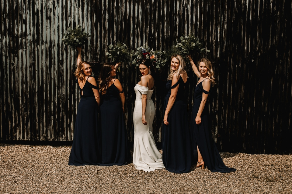 team bride and bridesmaids at the venue barns