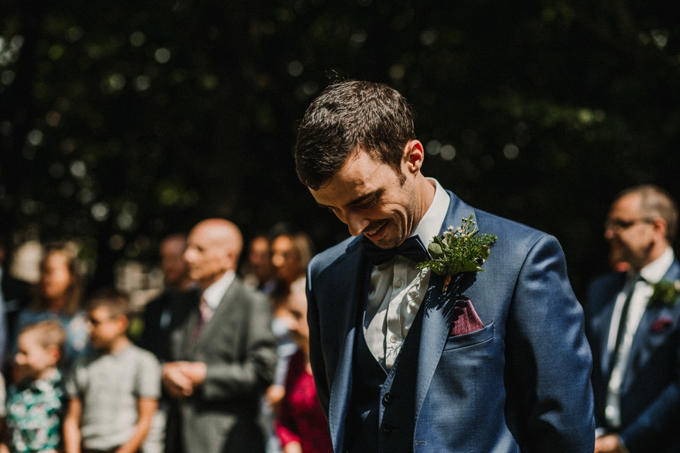 groom waiting for his wife to be walking down the aisle