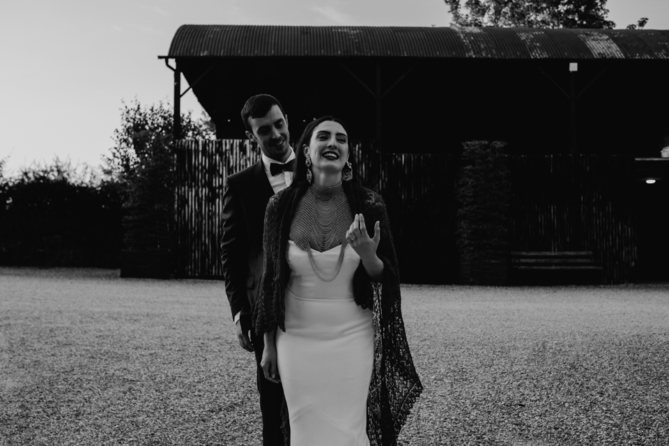 bride and groom laughing - crips barn