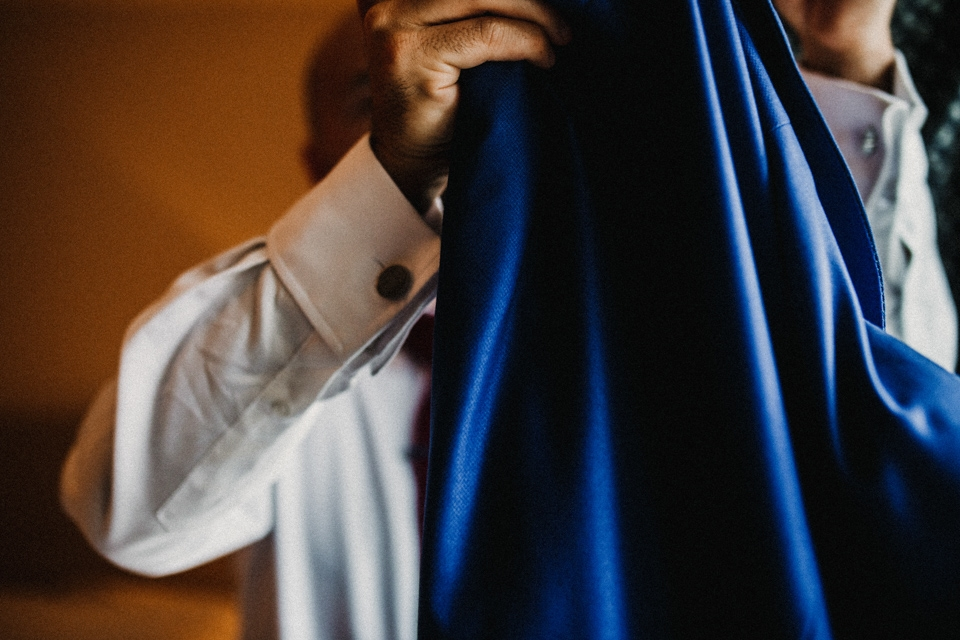 groom placing his jacket on