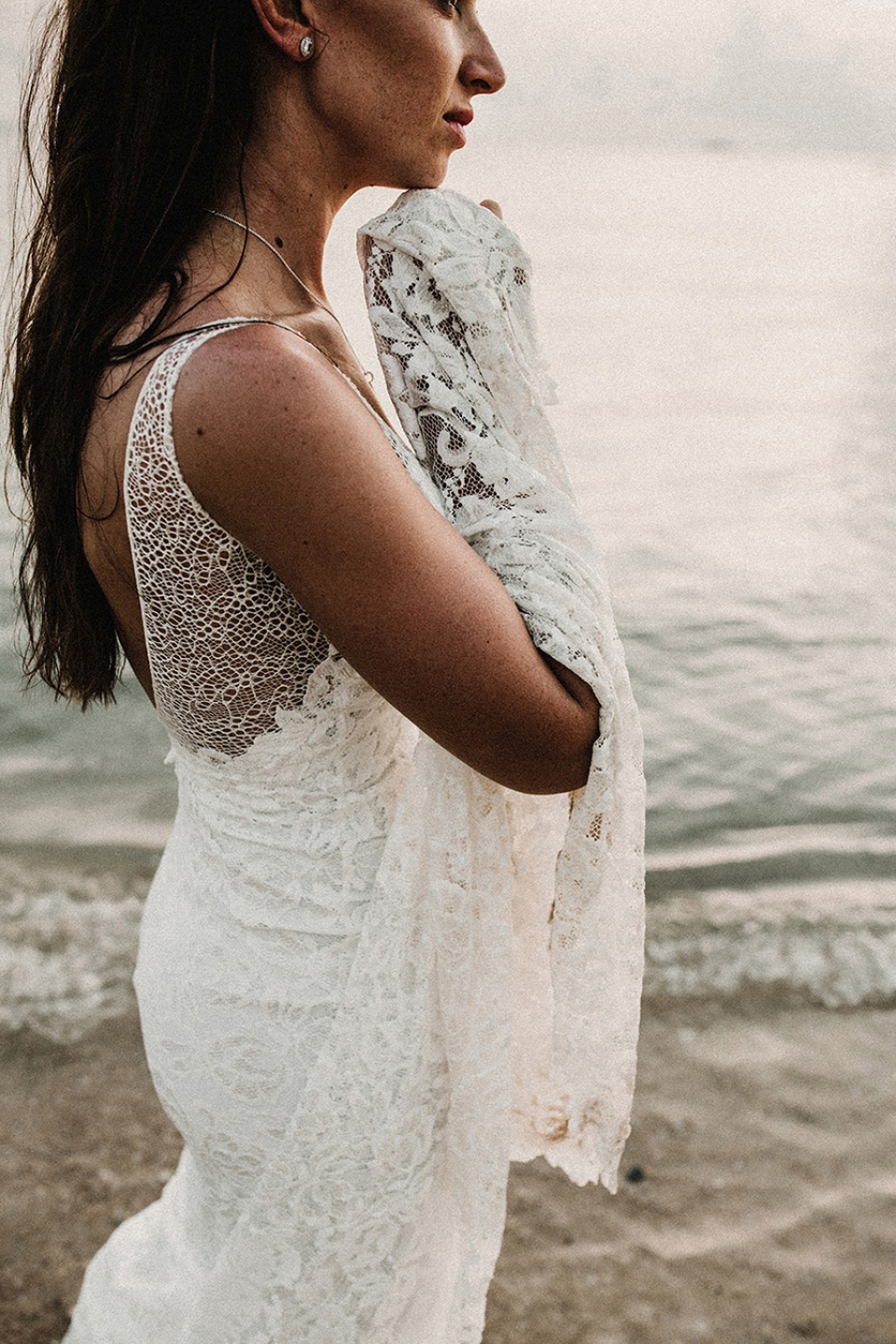 bride gazing out to see in grace loves lace dress