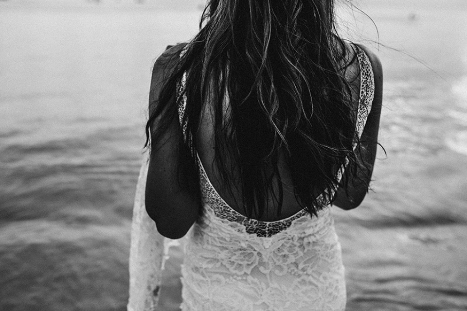 a black and white edit of brides hair on the beach in koh phangan