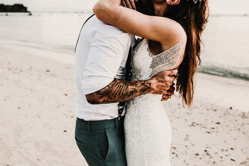 Bride wears grace loves lace and groom holds her was it exposing his tattooed arms