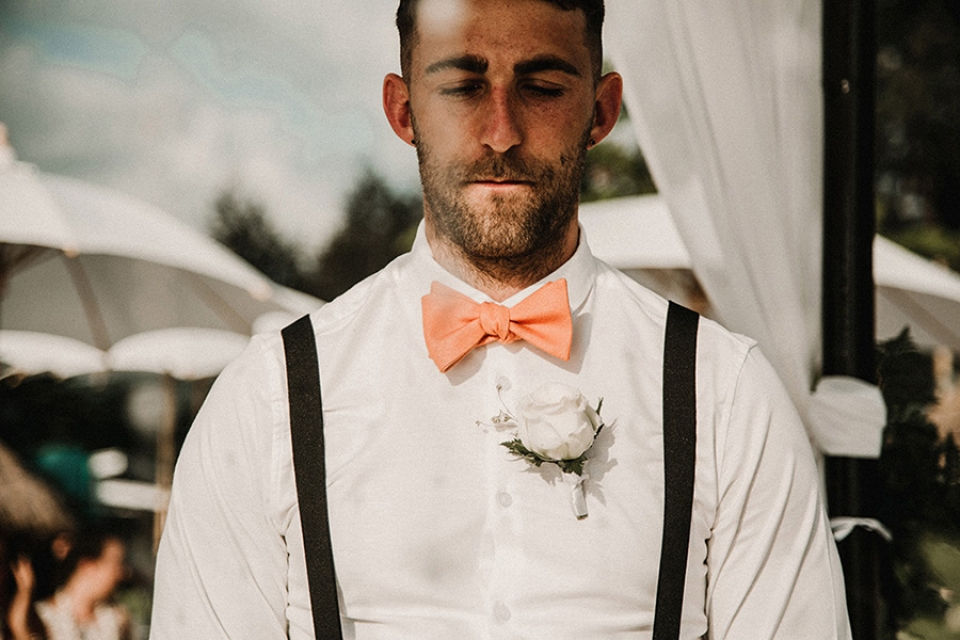 groom is nervous waiting for his wife to be to arrive