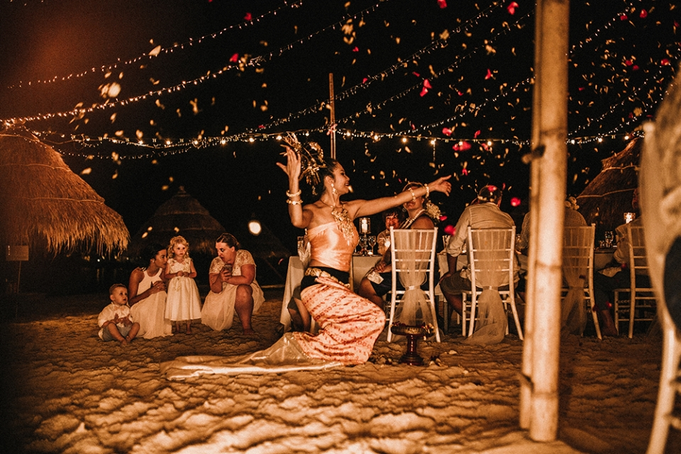 thai girl dancing in beautiful thai costume on beach