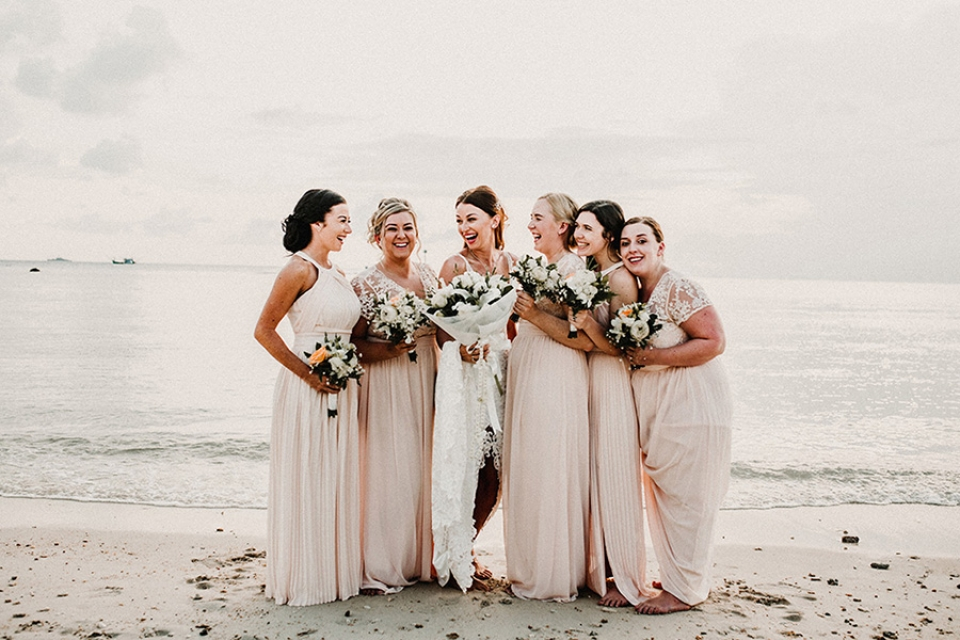 beautiful bridesmaids on nice sear resort beach