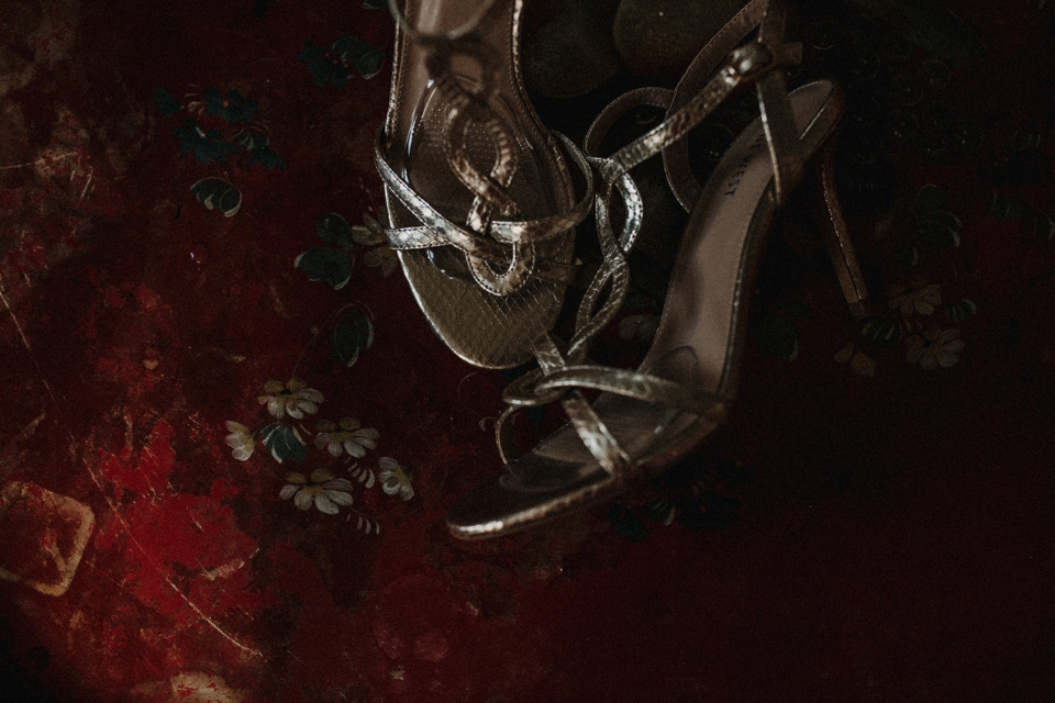 brides wedding shoes , on red table at Talbot hotel