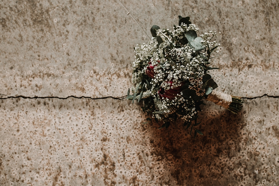 bridal bouquet laid onto industrial concrete flooring.