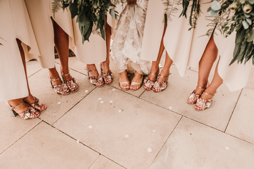brides and bridesmaids chatting and close up of their beautiful shoes.
