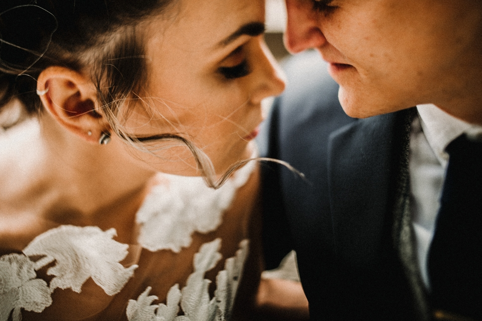 creative and intimate close up photograph of bride and groom in love